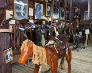 numerous saddles displayed inside a boxcar