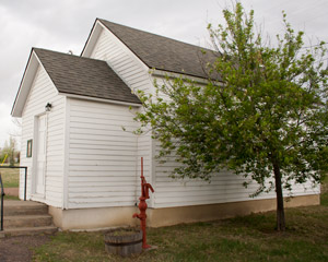 outside of the white one-room school house